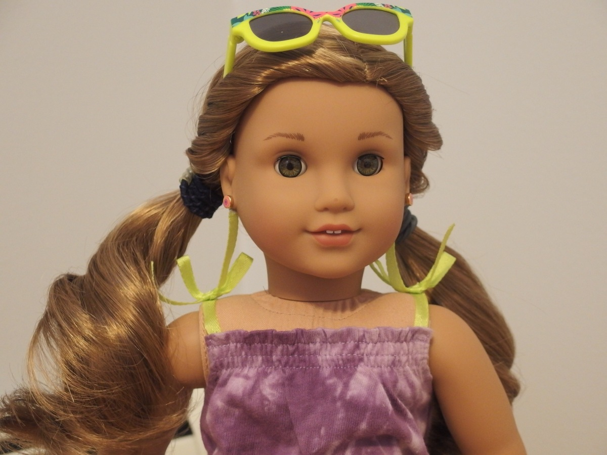 Avia with exclusive sunglasses, wearing exclusive dress, hair is in twisty pigtails